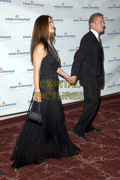 CATHERINE ZETA JONES & MICHAEL DOUGLAS.3rd Annual Adopt-A-Minefield Benefit Gala, Beverly Hilton Hotel.full length, full-length, long black dress, holding hands.www.capitalpictures.com.sales@capitalpictures.com.©Capital Pictures.