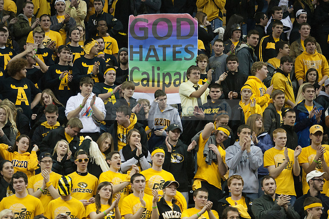 """The Missouri student section holds a sign reading """"God hates Calipari"""" during the game between the University of Kentucky men's basketball team and University of Missouri in Columbia, Mo.,on Saturday, February 1, 2014. Kentucky defeated Missouri 84-79. Photo by Michael Reaves 