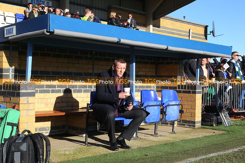 Northampton manager Aidy Boothroyd has a cup of tea in the dugout ahead of the game - Bishop's Stortford vs Northampton Town - FA Challenge Cup 1st Round Proper Round Football at the Profit UK Stadium, Bishop's Stortford - 10/11/13 - MANDATORY CREDIT: Gavin Ellis/TGSPHOTO - Self billing applies where appropriate - 0845 094 6026 - contact@tgsphoto.co.uk - NO UNPAID USE