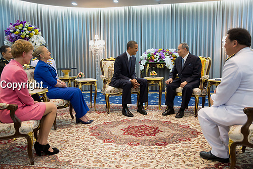 President Barack Obama, with Secretary of State Hillary Rodham Clinton and Ambassador Kristie Kenney, left, meet with King Bhumibol Adulyadej of the Kingdom of Thailand, at Siriraj Hospital in Bangkok, Thailand, Nov. 18, 2012. (Official White House Photo by Pete Souza)<br /> <br /> This official White House photograph is being made available only for publication by news organizations  The photograph may not be manipulated in any way and may not be used in commercial or political materials, advertisements, emails, products, promotions that in any way suggests approval or endorsement of the President, the First Family, or the White House.