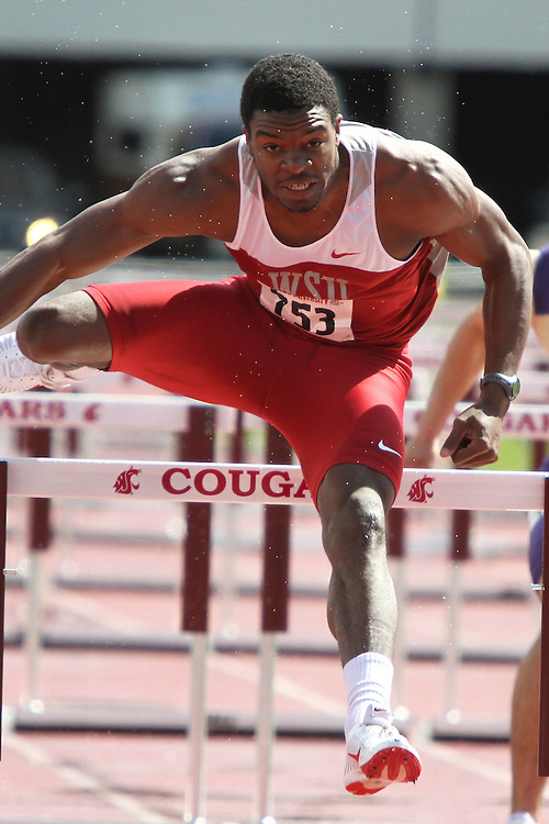 Jeshua Anderson, Washington State junior, clears the final hurdle while demolishing the rest of the field in the rainy and inclement weather in the 110 meter hurdles final during the Cougars dual track and field meet with arch-rival Washington at Mooberry Track at Washington State University in Pullman, Washington, on May 1, 2010.