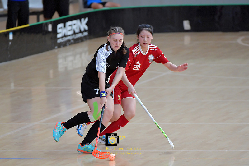 New Zealand's Sophie Scott and Korea's Jisoo Choi in action during the World Floorball Championships 2017 Qualification for Asia Oceania Region - New Zealand v Korea at ASB Sports Centre , Wellington, New Zealand on Sunday 5 February 2017.<br /> Photo by Masanori Udagawa<br /> www.photowellington.photoshelter.com.