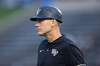 Wake Forest Demon Deacons head coach Tom Walter (16) coaches third base during the game against the West Virginia Mountaineers in Game Six of the Winston-Salem Regional in the 2017 College World Series at David F. Couch Ballpark on June 4, 2017 in Winston-Salem, North Carolina.  The Demon Deacons defeated the Mountaineers 12-8.  (Brian Westerholt/Four Seam Images)