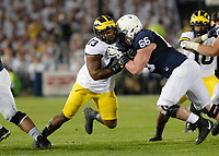 STATE COLLEGE, PA - OCTOBER 21:  Michigan DT Maurice Mo Hurst (73) fights off a block by Penn State C Connor McGovern (66). The Penn State Nittany Lions defeated the Michigan Wolverines 42-13 on October 21, 2017 at Beaver Stadium in State College, PA. (Photo by Randy Litzinger/Icon Sportswire)