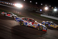 Apr 22, 2006; Phoenix, AZ, USA; Nascar Nextel Cup driver Mark Martin of the (6) AAA Ford Fusion races through traffic during the Subway Fresh 500 at Phoenix International Raceway. Mandatory Credit: Mark J. Rebilas-US PRESSWIRE Copyright © 2006 Mark J. Rebilas..