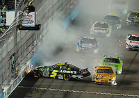 Apr 20, 2007; Avondale, AZ, USA; Nascar Busch Series driver Kyle Busch (5) crashes during the Bashas Supermarkets 200 at Phoenix International Raceway. Mandatory Credit: Mark J. Rebilas