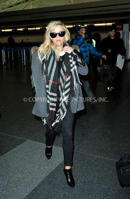 WWW.ACEPIXS.COM<br /> <br /> January 12 2015, New York City<br /> <br /> Actress Reese Witherspoon arrives at JFK Airport on January 12 2015 in New York City<br /> <br /> By Line: Curtis Means/ACE Pictures<br /> <br /> <br /> ACE Pictures, Inc.<br /> tel: 646 769 0430<br /> Email: info@acepixs.com<br /> www.acepixs.com