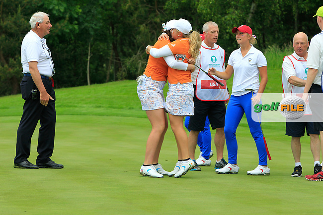Bronte Law jumps into the arms of Olivia Mehaffey after winning their game on the 16th green during the Saturday Mourning Foursomes of the 2016 Curtis Cup at Dun Laoghaire Golf Club on Saturday 11th June 2016.<br /> Picture:  Golffile | Thos Caffrey