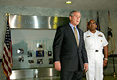 Bethesda, MD - August 1, 2006 -- United States President George W. Bush departs the National Naval Medical Center in Bethesda, Maryland, following his annual physical examination, August 1, 2006. Shown with the president is Commanding Officer Admiral Adam Robinson Jr. The President also distributed seven Purple Heart medals to soldiers during his visit.<br /> Credit: Martin H. Simon - Pool via CNP