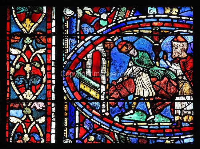 The father gives orders to a servant to kill the fatted calf for the celebratory feast, from the Parable of the Prodigal Son stained glass window, in the north transept of Chartres Cathedral, Eure-et-Loir, France. This window follows the parable as told by St Luke in his gospel. It is thought to have been donated by courtesans, who feature in 11 of the 30 sections. Chartres cathedral was built 1194-1250 and is a fine example of Gothic architecture. Most of its windows date from 1205-40 although a few earlier 12th century examples are also intact. It was declared a UNESCO World Heritage Site in 1979. Picture by Manuel Cohen