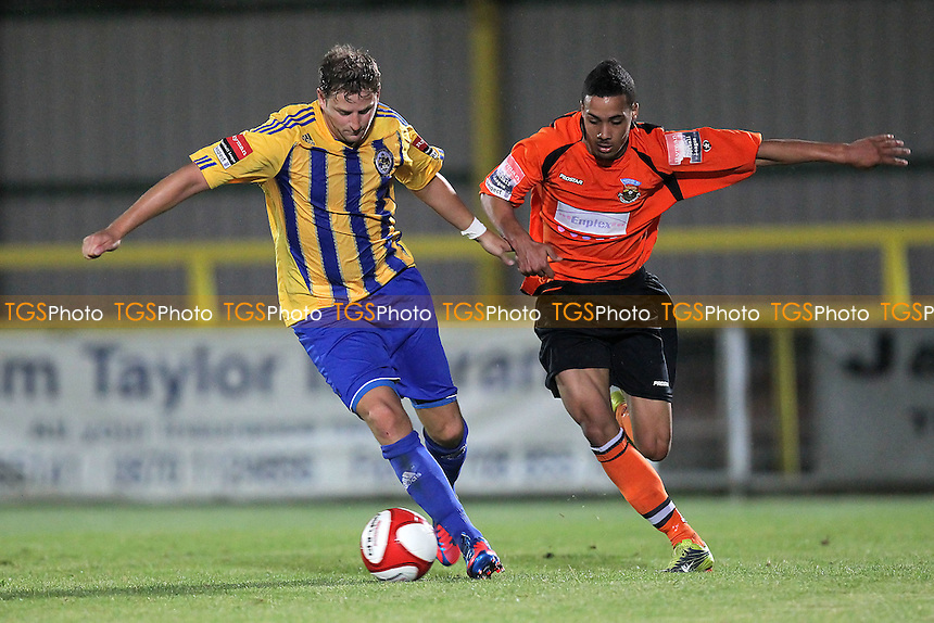 Bobby Port of Romford tangles with Luke Stanley of Waltham Forest - Romford vs Waltham Forest - FA Cup Preliminary Round Football at Ship Lane, Thurrock FC - 24/08/12 - MANDATORY CREDIT: Gavin Ellis/TGSPHOTO - Self billing applies where appropriate - 0845 094 6026 - contact@tgsphoto.co.uk - NO UNPAID USE.