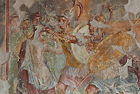 Fresco detail of Helen and Menelaus, with Menelaus grabbing Helen, from the East wall of the Triclinium, probably used for lunches, a large room open to the garden, with walls painted on a white background with figures and plants and ornamental borders and floating figures of the seasons, in the Casa dell Efebo, or House of the Ephebus, Pompeii, Italy. This room is decorated in the Fourth Style of Roman wall painting, 60-79 AD, a complex narrative style. This is a large, sumptuously decorated house probably owned by a rich family, and named after the statue of the Ephebus found here. Pompeii is a Roman town which was destroyed and buried under 4-6 m of volcanic ash in the eruption of Mount Vesuvius in 79 AD. Buildings and artefacts were preserved in the ash and have been excavated and restored. Pompeii is listed as a UNESCO World Heritage Site. Picture by Manuel Cohen