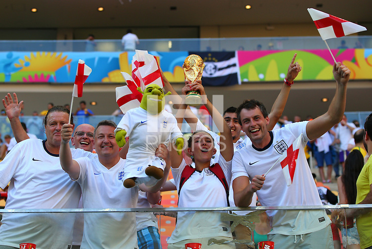 England fans hold up a replica world cup as they soak up the atmosphere ahead of kick off
