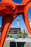"Seen up close, the vivid red of Alexander Calder's, ""Eagle, 1971"" contrasts with the vivid blue of a Northwest sky and the white spire of the Space Needle several blocks away.   SAM's Olympic Sculpture Park, Seattle, WA."