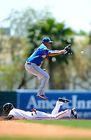 New York Mets shortstop Ruben Tejada #11 takes a throw as Kyle Hudson slides in during a Spring Training game against the Baltimore Orioles at Ed Smith Stadium on March 30, 2013 in Sarasota, Florida.  (Mike Janes/Four Seam Images)
