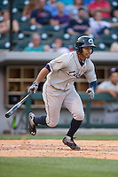 Francisco Lindor (12) of the Columbus Clippers follows through on his swing against the Charlotte Knights at BB&T BallPark on May 27, 2015 in Charlotte, North Carolina.  The Clippers defeated the Knights 9-3.  (Brian Westerholt/Four Seam Images)
