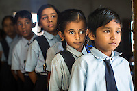 Children from ages 4 to 16 line up for morning assembly in the Vasudha Vidya Vihar school in Khargone, Madhya Pradesh, India on 12 November 2014. This school was built using the Fairtrade Premium funds of the Fairtrade cotton farmers and producers in Karhi village of Khargone. Photo by Suzanne Lee for Fairtrade