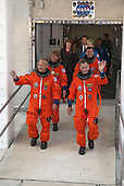 Dressed in their bright-orange launch-and-entry suits, the final four astronauts to launch aboard a space shuttle exit the Astronaut Crew Quarters in the Operations and Checkout Building at NASA's Kennedy Space Center in Cape Canaveral, Florida on July 8, 2011. In the left row, STS-135 Pilot Doug Hurley is followed by Mission Specialist Sandy Magnus. In the right row, Commander Chris Ferguson is followed by Mission Specialist Rex Walheim. The astronauts, who will head to Launch Pad 39A aboard the silver Astrovan, are scheduled to lift off aboard space shuttle Atlantis at 11:26 a.m. EDT on July 8 for their mission to the International Space Station. STS-135 will deliver the Raffaello multi-purpose logistics module packed with supplies and spare parts for the orbiting outpost. Atlantis also will fly the Robotic Refueling Mission experiment that will investigate the potential for robotically refueling existing satellites in orbit. In addition, Atlantis will return with a failed ammonia pump module to help NASA better understand the failure mechanism and improve pump designs for future systems. STS-135 will be the 33rd flight of Atlantis, the 37th shuttle mission to the space station, and the 135th and final mission of NASA's Space Shuttle Program. .Mandatory Credit: Kim Shiflett / NASA via CNP