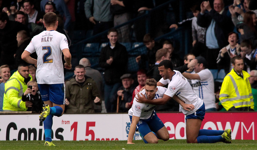 Bury's Chris Hussey (second right) celebrates scoring his sides third goal with team-mate Jacob Mellis<br /> <br /> Photographer David Shipman/CameraSport<br /> <br /> Football - The Football League Sky Bet League One - Bury v Blackpool - Saturday 31st October 2015 - Gigg Lane - Bury <br /> <br /> &copy; CameraSport - 43 Linden Ave. Countesthorpe. Leicester. England. LE8 5PG - Tel: +44 (0) 116 277 4147 - admin@camerasport.com - www.camerasport.com