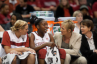 LOS ANGELES, CA - March 11, 2011:  Stanford's Joslyn Tinkle (l), assistant coach Kate Paye and head coach Tara VanDerveer ask Chiney Ogwumike about her chipped tooth during the semi-final game of the 2011 Pac-10 Tournament game against the Arizona Wildcats at Staples Center.  Stanford won, 100-71.