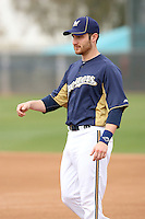Jonathan Lucroy #20 of the Milwaukee Brewers participates in drills during spring training workouts at the Brewers complex on February 18, 2011  in Phoenix, Arizona. .Photo by Bill Mitchell / Four Seam Images.
