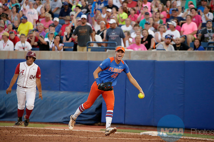 02 JUNE 2014:  Taylor Schwarz (49) of the University of Florida celebrates after a double play against the University of Alabama during the Division I Women's Softball Championship held at ASA Hall of Fame Stadium in Oklahoma City, OK.  Florida defeated Alabama 5-0 in Game One.  Shane Bevel/NCAA Photos