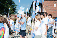 Supporters of Democratic presidential candidate Bernie Sanders prepare to march in the Labor Day parade in Milford, New Hampshire.  Republican candidates John Kasich, Carly Fiorina, and Lindsey Graham also marched in the parade.
