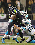 Seattle Seahawks  running back Robert Turbin (22) is tackled after running for a short gain by Carolina Panthers linebacker Luke Kuechly (59) in the NFC Western Division Playoffs at CenturyLink Field  on January 10, 2015 in Seattle, Washington. The Seahawks beat the Panthers 31-17. ©2015. Jim Bryant Photo. All Rights Reserved.