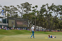 Matt Fitzpatrick (ENG) and his caddie look over his putt on 18 during round 3 of The Players Championship, TPC Sawgrass, at Ponte Vedra, Florida, USA. 5/12/2018.<br /> Picture: Golffile | Ken Murray<br /> <br /> <br /> All photo usage must carry mandatory copyright credit (&copy; Golffile | Ken Murray)
