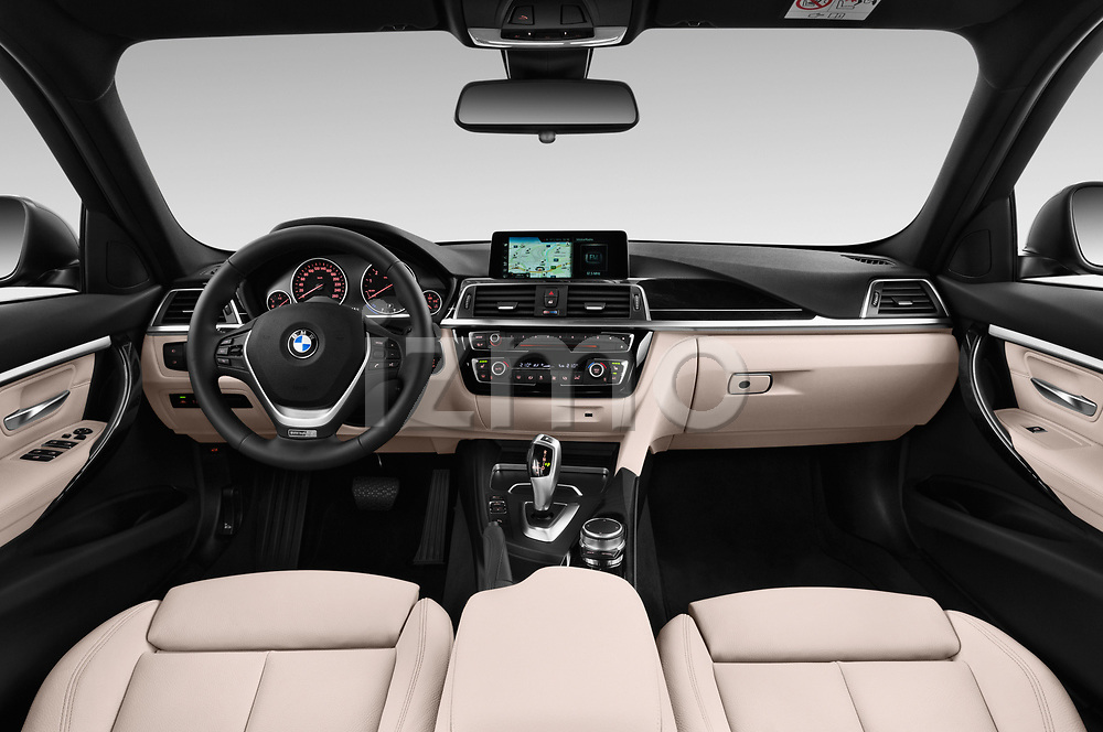 Stock photo of straight dashboard view of a 2017 BMW 3 Series Touring Luxury 5 Door Wagon