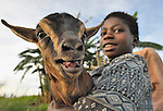 A boy cares for one of his family's goats in Matuli, Malawi.