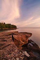 Sunrise light glows over Lake Superior from a point at Big Bay State Park on Madeline Island in the Apostle Island chain, Ashland County, Wisconsin