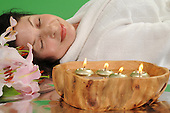 Stock photo of woman relaxing in spa setting