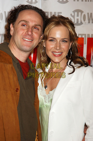 JOHN KASSIR & JULIE BENZ.The L-Word Second Season Premiere Start-Studded Screening held at the Directors Guild of America. Los Angeles, California.February 16th, 2005.Photo Credit: Laura Farr/AdMeida.headshot portrait.www.capitalpictures.com.sales@capitalpictures.com.© Capital Pictures.