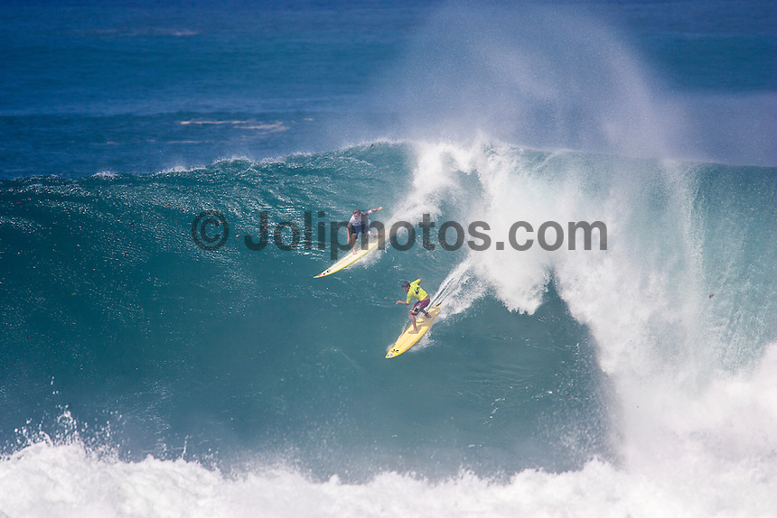 Waimea Bay, North Shore, Oahu, Hawaii December 15 2004.<br /> Mark Healey (HAW) and Bruce Irons (HAW) - The 2004 Quiksilver Eddie Aikau Big Wave Invitational won by Hawaiian surfer Bruce Irons (HAW) from the island of Kauai was held in 30 to 40' waves at Waimea Bay on the North Shore of Oahu Hawaii, today, December 15th 2004. Irons rode one of the biggest waves of the day which was at least 30' in height, taking home US$55,000 in prize money.  Photo: Joliphotos.com