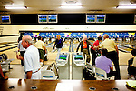 People ready for a bowling tournament at the Bell Recreation Center bowling alley in Sun City, Arizona March 13, 2010. 2010 marks the 50th anniversary of Sun City, the first planned retirement city in the United States.