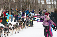 Zoya DeNure and team run past spectators on the bike/ski trail near University Lake with an Iditarider in the basket and a handler during the Anchorage, Alaska ceremonial start on Saturday, March 7 during the 2020 Iditarod race. Photo © 2020 by Ed Bennett/Bennett Images LLC