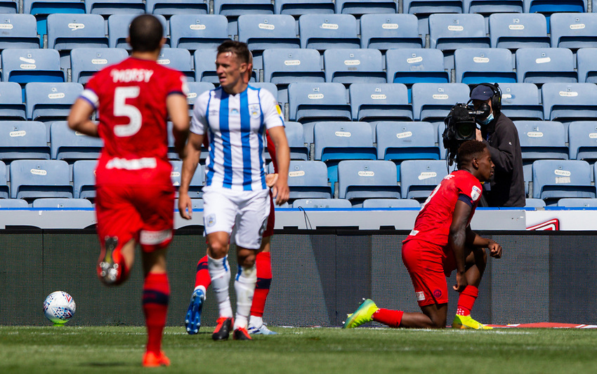 Wigan Athletic's Jamal Lowe celebrates scoring the opening goal<br /> <br /> Photographer Alex Dodd/CameraSport<br /> <br /> The EFL Sky Bet Championship - Huddersfield Town v Wigan Athletic - Saturday 20th June 2020 - John Smith's Stadium - Huddersfield <br /> <br /> World Copyright © 2020 CameraSport. All rights reserved. 43 Linden Ave. Countesthorpe. Leicester. England. LE8 5PG - Tel: +44 (0) 116 277 4147 - admin@camerasport.com - www.camerasport.com
