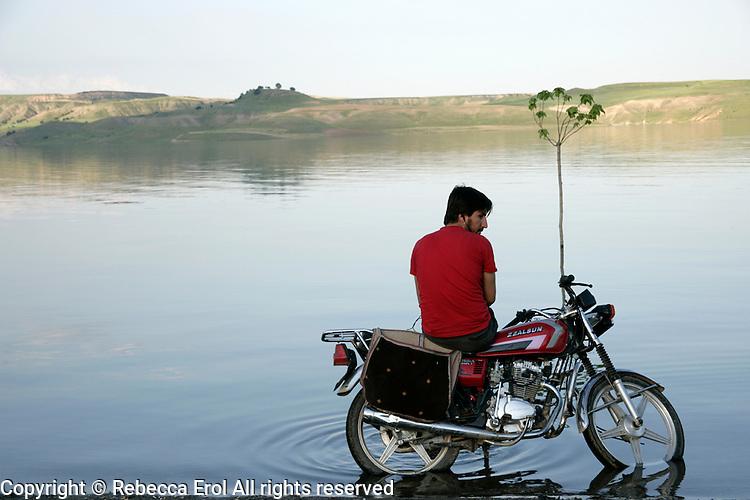 Lone motorcyclist at Lake Ataturk, near Kahta, Adiyaman, southeastern Turkey