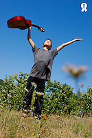 Boy (10-11) standing in meadow, holding guitar in outstretched arms, low angle view (Licence this image exclusively with Getty: http://www.gettyimages.com/detail/sb10065474bd-001 )