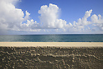 The sky, clouds, ocean and sea wall in San Juan, Puerto Rico