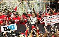 Ohio State Buckeyes wide receiver Terry McLaurin and head coach Urban Meyer hoist the Amos Alonzo Stagg Championship Trophy as the team celebrates following their 45-24 win over the Northwestern Wildcats in the Big Ten Championship at Lucas Oil Stadium in Indianapolis on Dec. 1, 2018. [Adam Cairns/Dispatch]