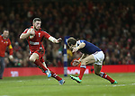 Wales wing Alex Cuthbert tries to beat his opposite number Hugo Bonneval.<br /> RBS 6 Nations 2014<br /> Wales v France<br /> Millennium Stadium<br /> 21.02.14<br /> <br /> ©Steve Pope-SPORTINGWALES