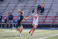 College Park, MD - April 27, 2019: Maryland Terrapins midfielder Jen Giles (5) passes the ball during the game between John Hopkins and Maryland at  Capital One Field at Maryland Stadium in College Park, MD.  (Photo by Elliott Brown/Media Images International)