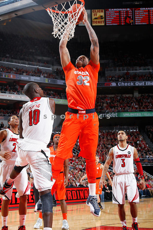 LOUISVILLE, KY - JANUARY 19: DaJuan Coleman #32 of the Syracuse Orange goes up for a dunk against the Louisville Cardinals during the game at KFC Yum! Center on January 19, 2013 in Louisville, Kentucky. Syracuse defeated Louisville 70-68. DaJuan Coleman