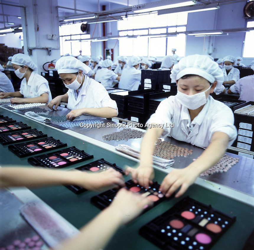 Workers on a production line   producing lipstick, mascara and other cosmetics at a factory in the Pear River Delta in Fu Yong, near the Shenzhen special Economic Zone in China.