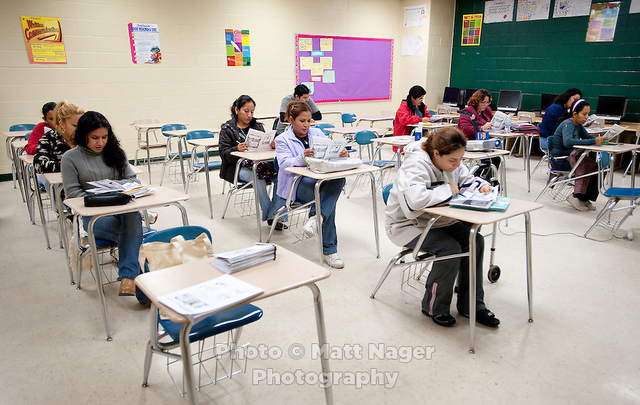 Adults participate in an English learning class designed to help teach and read English as well as prepare for the US Citizenship test at the Nixon High School Literacy Center in Laredo, Texas, US, Wednesday, Dec. 9, 2009. With over 95 percent of the population as Hispanic Spanish speakers, Laredo ranked the lowest in literacy rates in the 2000 US census. Today there are a number of bi-lingual and dual language classes set up to help students and adults learn english...PHOTOS/ MATT NAGER