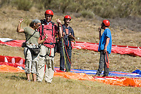 Saint Vincent-les-Forts, Lac de Serre Poncon, France, September 2007. Instructor Aniek Peters, guides a student into the air.  Op Pad Magazine winner Arie van de Wetering was selected for paragliding training. Volantis is home to the paragliding school Inferno. In one week time, students learn to fly the paraglider and earn their mountain licence 1. Photo by Frits Meyst/Adventure4ever.com
