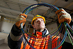 Pix: Shaun Flannery/shaunflanneryphotography.com...COPYRIGHT PICTURE>>SHAUN FLANNERY>01302-570814>>07778315553>>..26th January 2011.........Contractors, Houlton, re-start work on the Church View site, Doncaster..Operative Shane Higgins (orange jacket).
