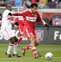 Chicago Fire defender Wilman Conde (22) shields New York Red Bulls forward Dominic Oduro (25) from the ball.  The Chicago Fire defeated the New York Red Bulls 1-0 at Toyota Park in Bridgeview, IL on April 5, 2009. Photo by Tracy Allen / isiphotos.com